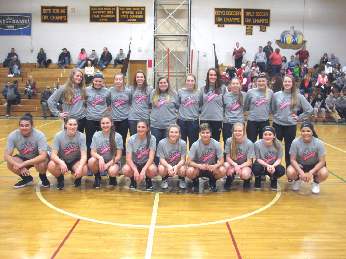 "Members of the Falconer and Ellicottville girls basketball teams pose for a picture Tuesday during the eighth annual ""Hoops for Hospice"" event. Funds raised this year will be donated in memory of Rosemary Billquist.  P-J photo by Noah Rankin"
