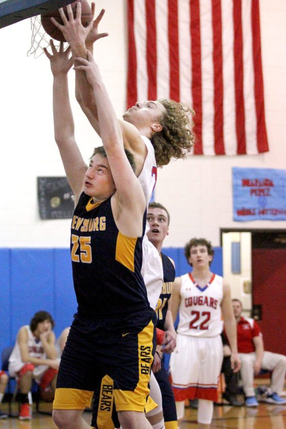 Frewsburg's Jvyn Matve (25) and Cassadaga Valley's Connor Crabtree battle for a rebound during their CCAA Division 2 West matchup in Sinclairville on Tuesday.