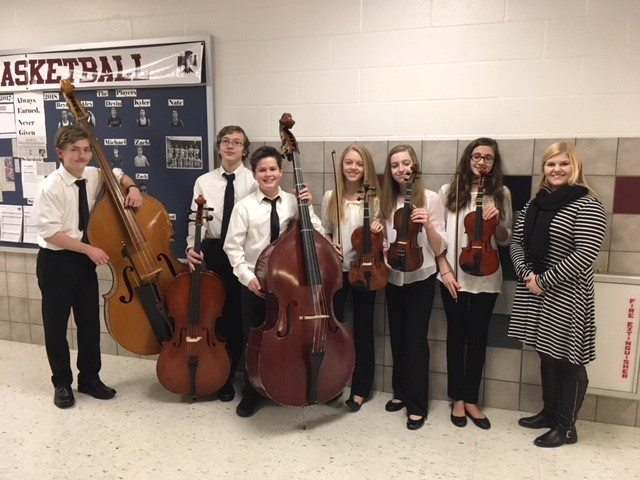 Eighth-grade musicians Braley Lachner, Ethan Livingston, Tucker Gesing, Emma Anderson, Mary Rose Slater, and Josephine Corey with Southwestern orchestra director Marie Karbacka.