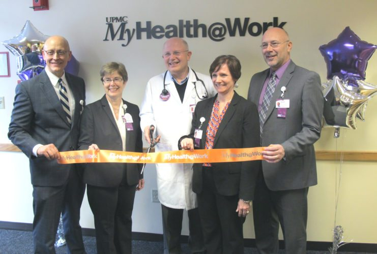 From left, Cecil Miller, UPMC Chautauqua WCA vice president of operations; Betsy T. Wright, WCA president and chief executive officer; Dr. Todd Jacobson, WCA physician services director; Trish Smith, WCA clinical operations director; and Dan Tota, physician services director, during the ribbon cutting ceremony for the MyHealth@Work Center the hospital has opened for all of their employees at the Occupational Health Building at Jones Memorial Health Center, located at 51 Glasgow Ave. P-J photo by Dennis Phillip