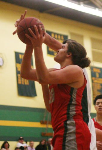 At right, Jamestown's Marcus Rojas looks to the basket during the Red Raiders' ECIC Division 1 game against Williamsville North on Wednesday night in Williamsville. P-J photo by Scott Kindberg