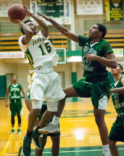 Jamestown CC's Averi Parker is defended by Mercyhurst North East's Will Jackson during their NJCAA Region 3 Division II men's basketball game Wednesday night at the Physical Education Complex. P-J photo by Valory S. Isaacson