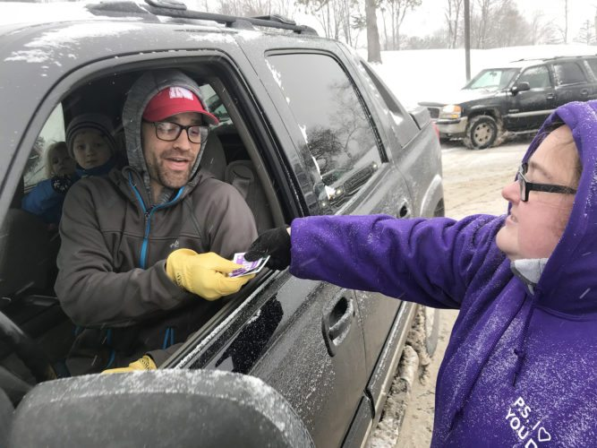 Ring Elementary School teacher Carrie Davenport gave parent Jay Baehr a treat during student drop-off in the morning in honor of the school's P.S. I Love You Day.