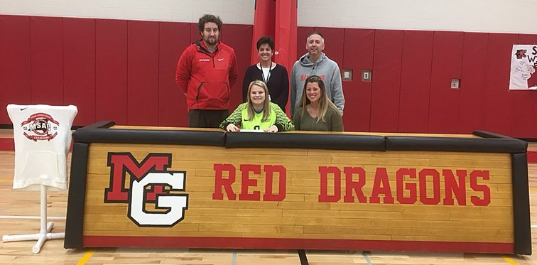 Sky Tarapacki, seated left, signs her letter of intent to attend Corning Community College where she will continue her academic and soccer career in the fall. Seated at right is Bethany Seastrum, Sky's mother. Standing, from the left, are Kyle Leach, Corning CC women's soccer coach; Julie Verdonik, Maple Grove principal; and Mike Burr, Maple Grove girls soccer coach. Submitted photo