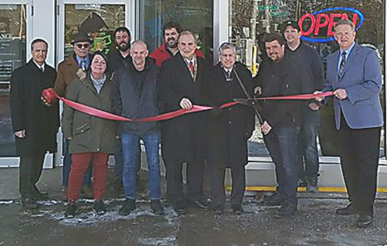 Local dignitaries and Spartara officials cutting the ribbon on its retail and service location, GeekLynk, which is located at the Third Street Plaza.  Submitted photo