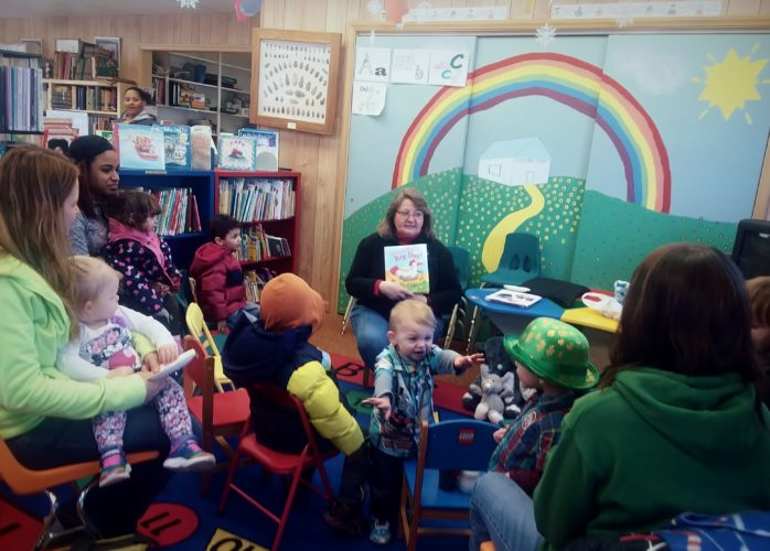 Library Director Lynn Grundstrom's reading circle for children on Tuesdays. Photos by Sandy Robison