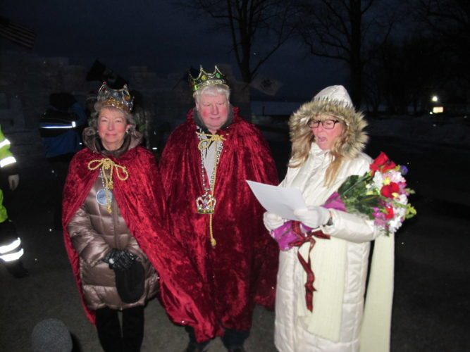 Jean and Mike Lobaugh, the 2018 festival's crowned queen and king, are pictured in red robes.