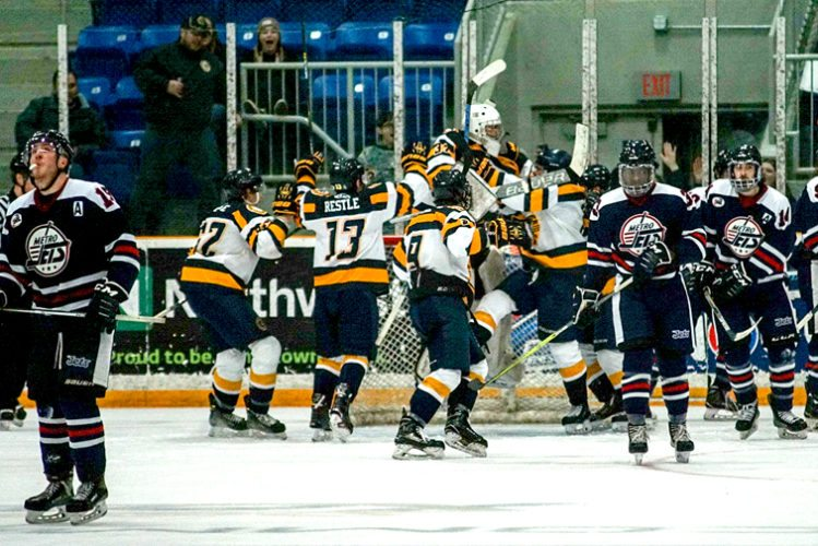 Southern Tier goaltender is mobbed as he jumps in celebration of the Xpress' 4-3 win over first-place Metro in North American Tier III Hockey League action Friday at Northwest Arena. P-J photo by Chad Ecklof
