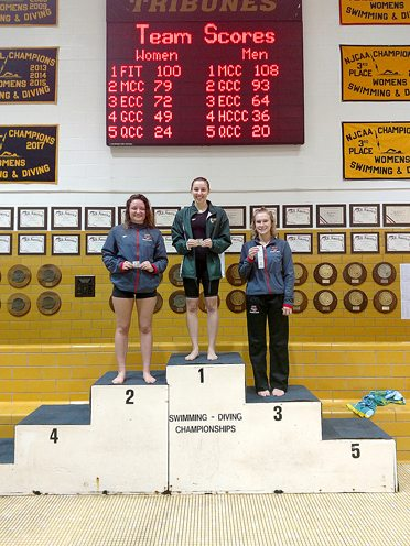 Christine Kuzminski is pictured on top of the podium after winning Friday. Submitted photo