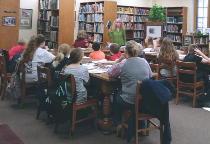 Falconer Public Library director, Sue Seamans, meets with students from Falconer Central School to discuss the importance of understanding history. This is one of the many programs Seamans, and the Falconer Public Library staff, host at the library.