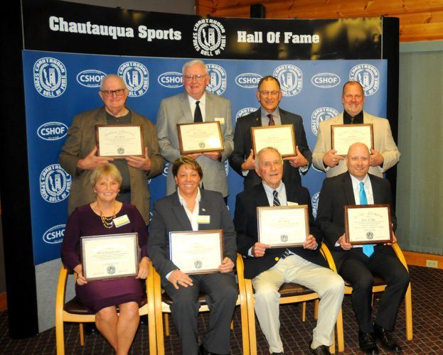 Chautauqua Sports Hall of Fame inductees, pictured in front, from left, are: Sheilah Lingenfelter Gulas; Lori Franchina; Phil Young; and Jim Riggs IV, representing his late father, Jim Riggs III. In back are: Clem Worosz; Dick Cole; Fran Sirianni; and Curt Fischer. P-J photo by Scott Kindberg