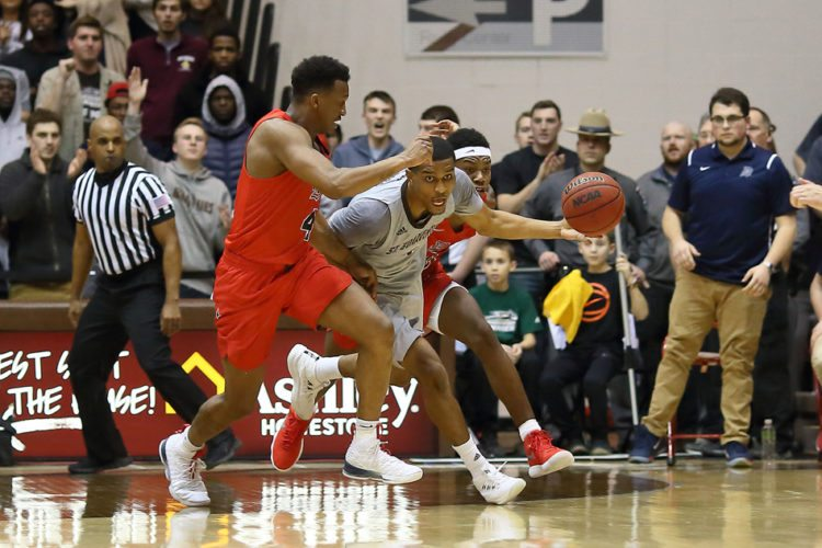 St. Bonaventure's Idris Taqqee comes up with a steal against Duquesne on Wednesday night during Atlantic 10 men's basketball action at the Reilly Center. P-J photo by Tim Frank