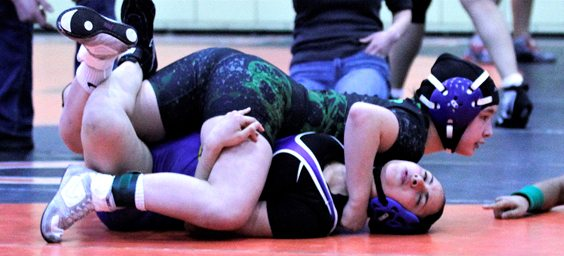 Mika Walters is pictured wrestling in action on her way to a state title. Submitted photo