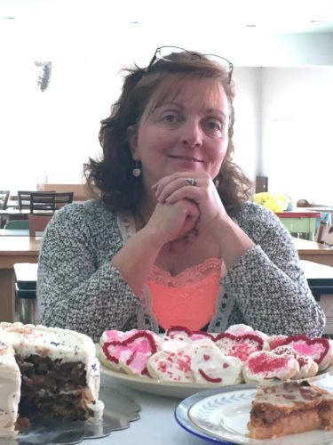 Angie Mardino-Miller has seen lives changed at The Master's Plan Cafe and The Master's Plan Community Church in Dayton. Sam's Carrot Cake, Soft Cut-Out Sugar Cookies and Spaghetti Pie are in the foreground.