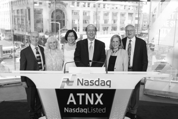 Athenex co-founders David Hangauer (far left), Johnson Lau (center, above microphones) and Allen Barnett (far right) with their wives at the Nasdaq exchange.  Submitted photo