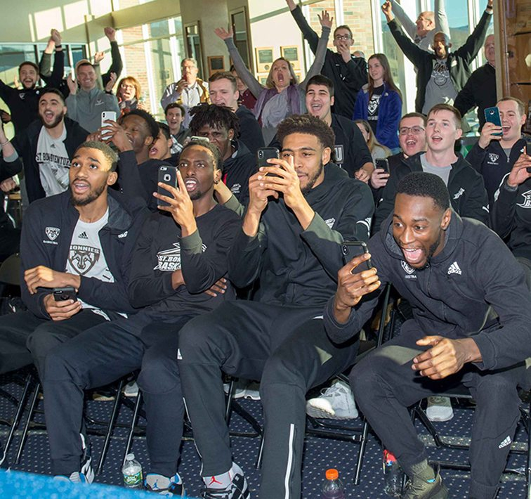The St. Bonaventure University basketball team reacts to the news that they had earned an at-large bid to the NCAA Tournament on Sunday. The Bonnies will play UCLA in the First Four on Tuesday at UD Arena in Dayton Ohio. The game is scheduled for a 9:10