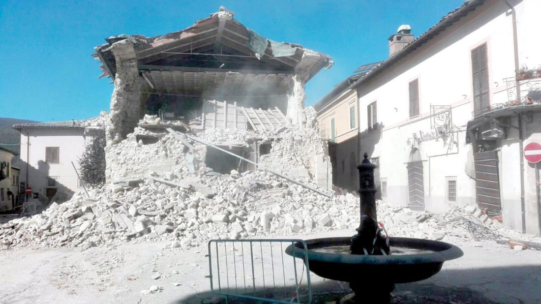 The Church of San Francesco is covered with dust and rubble, in Norcia, central Italy, after an earthquake with a preliminary magnitude of 6.6 struck Sunday, Oct. 30, 2016. A powerful earthquake rocked the same area of central and southern Italy hit by quake in August and a pair of aftershocks last week, sending already quake-damaged buildings crumbling after a week of temblors that have left thousands homeless. (Matteo Guidelli/ANSA via AP)