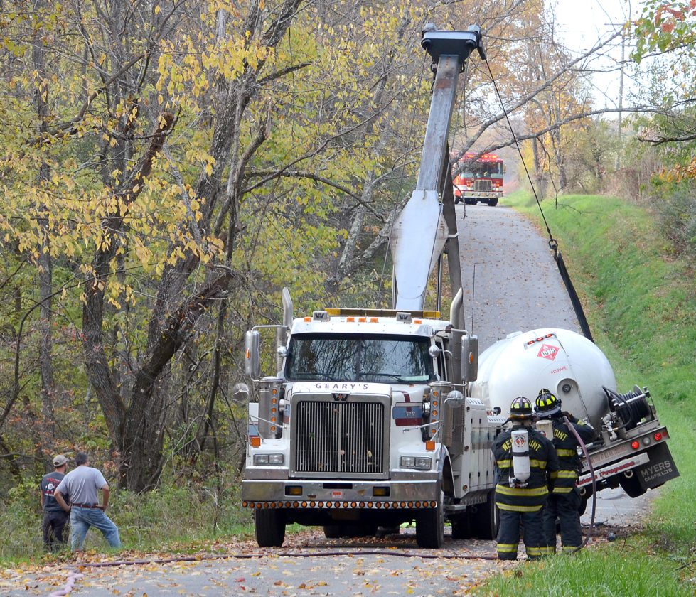 Ed Geary's Towing of Leetonia uprighted a propane truck Tuesday afternoon after it rolled when the driver attempted to avoid hitting a deer along Glasgow Road. (Photos by Patti Schaeffer)