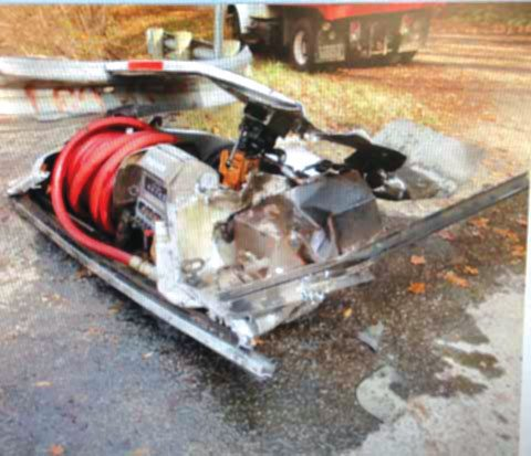 This pump and hose and a trail of oil were left behind by a truck that struck a guardrail at the entrance to the bridge over Beaver Creek on Grimm's Bridge Road. (Photo courtesy of St. Clair Township Police Department)