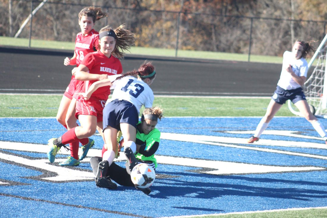 Beaver Local's Alexa Schwerha (16) and Leah Pancake scramble in front of the goal as Granville's Ciahnna Winston and Brooke Kauchak (13) have a little collision on Saturday in a Div. II regional final at Zanesville High School.
