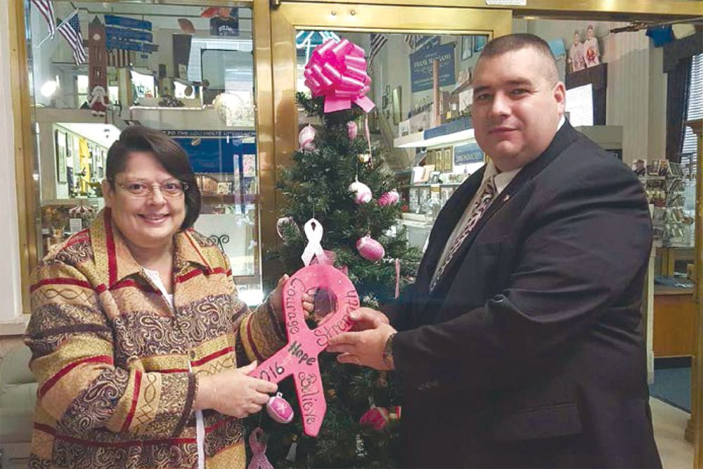 East Liverpool Mayor Ryan Stovall presented a trophy to Robin Webster (left) at the Lou Holtz Upper Ohio Valley Hall of Fame for best decorated in East Liverpool for CHANGE, Inc.'s Paint the Valley Pink 2016 contest. Robin is a two year survivor of breast cancer and Rosemary Mackall (not pictured), a 10-year survivor, so this was a heartfelt win for them. (Submitted photos)
