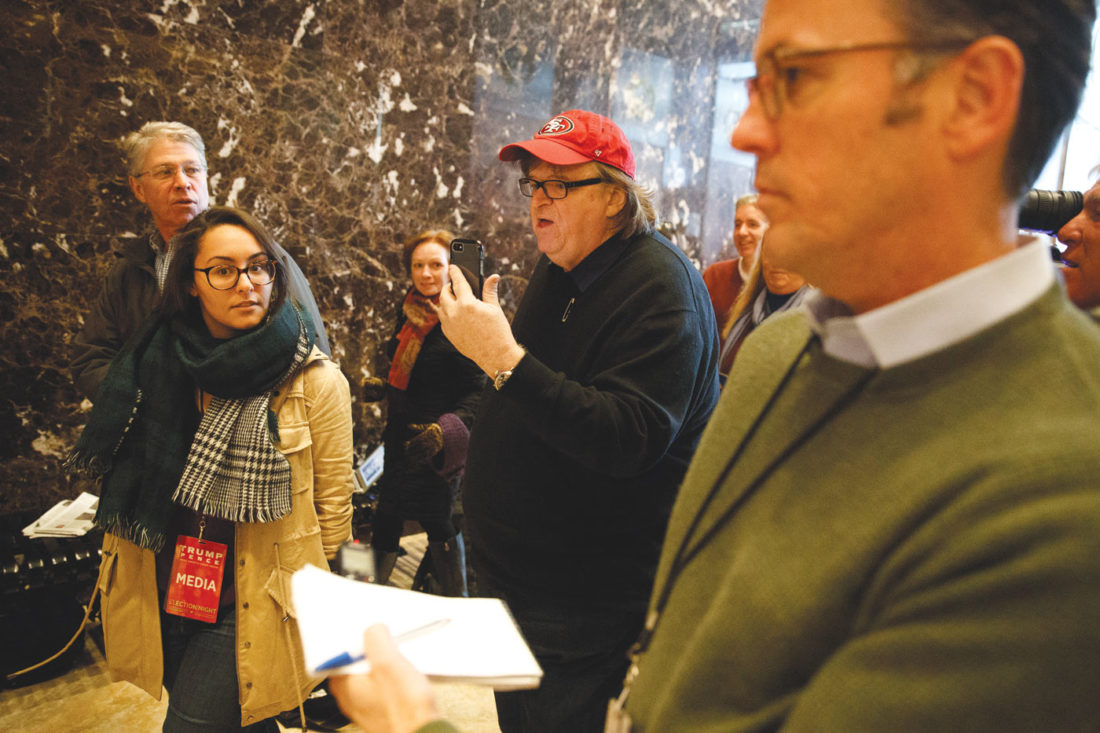 Filmmaker Michael Moore walks in the lobby of Trump Tower, Saturday, Nov. 12, 2016, in New York. (AP Photo/ Evan Vucci)