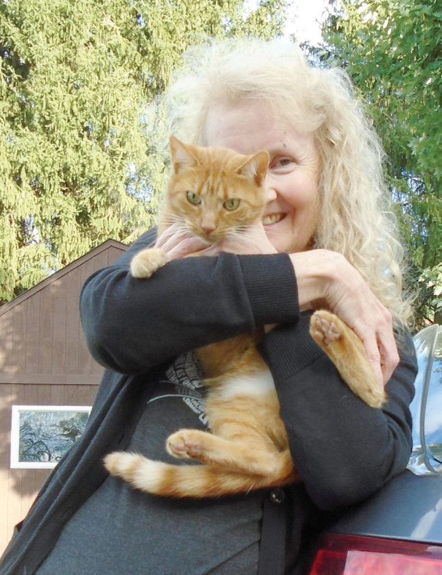 Author Janis Kell with one of her two cats, Sunny, which she adopted from the Hancock County Animal Shelter. (Submitted photo)
