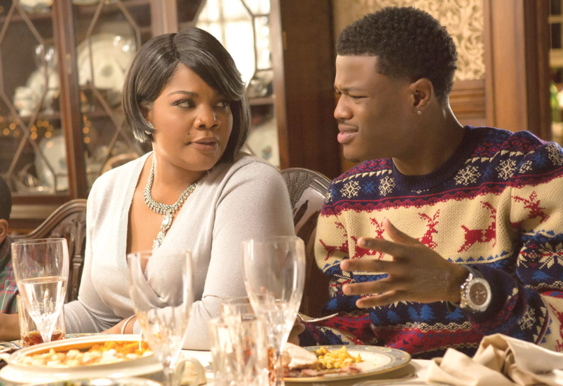 "In this image released by Universal Pictures, Mo'Nique, left, and DC Young Fly appear in a scene from the holiday film, ""Almost Christmas."" (Quantrell D. Colbert/Universal Pictures via AP)"