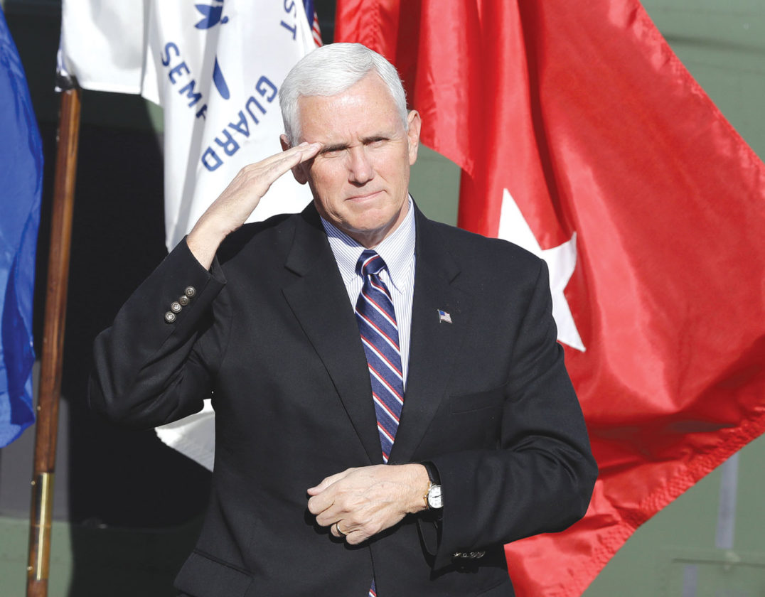 Vice President-elect Mike Pence salutes veterans during a Veterans Day ceremony at Camp Atterbury in Edinburgh, Ind., Friday, Nov. 11, 2016. (AP Photo/Darron Cummings)