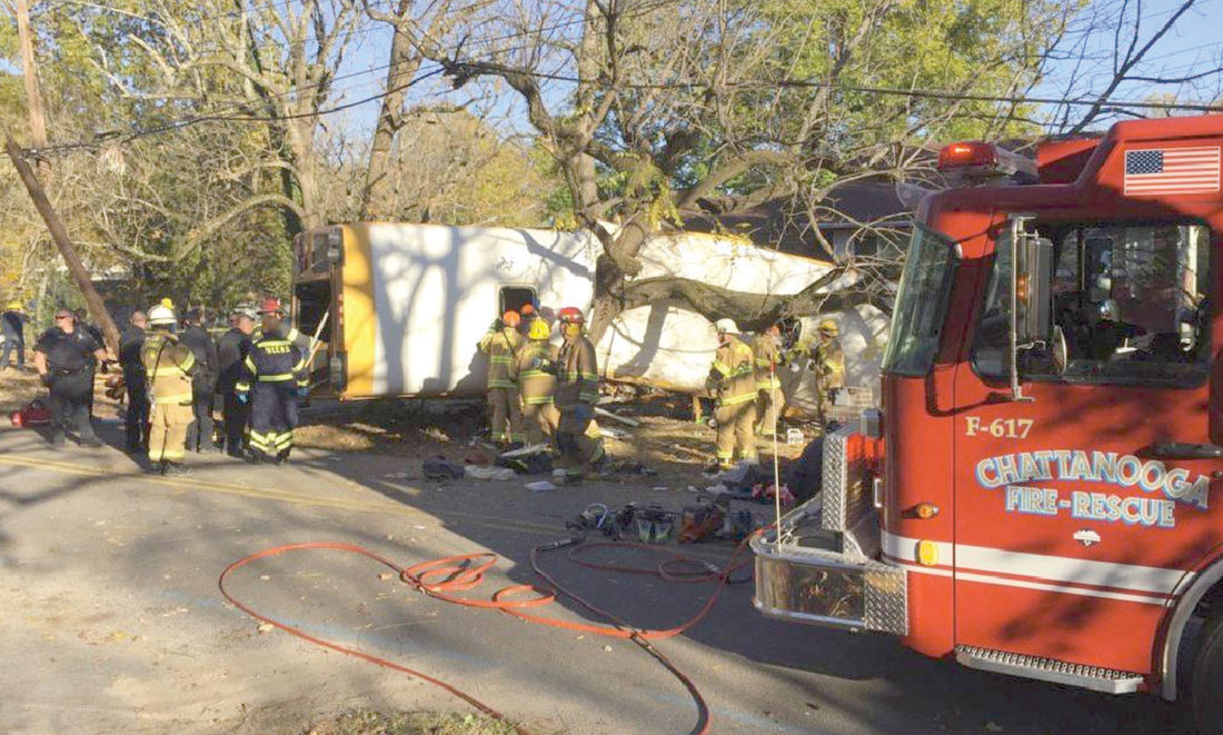 In this photo provided by the Chattanooga Fire Department via Chattanooga Times Free Press, Chattanooga Fire Department members work the scene of a fatal elementary school bus crash in Chattanooga, Tenn., Monday, Nov. 21, 2016. In a news conference Monday, Assistant Chief Tracy Arnold said there were multiple fatalities in the crash. (Bruce Garner/Chattanooga Fire Department via Chattanooga Times Free Press via AP)
