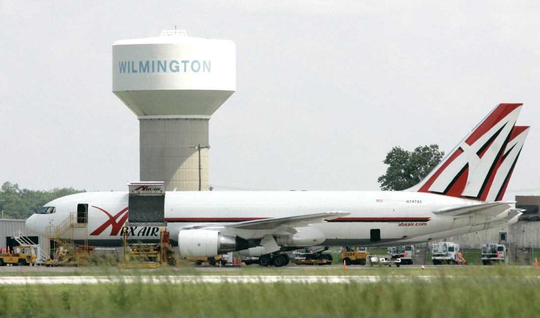 In this file photo, two ABX Air cargo planes sit at Wilmington Air Park, in Wilmington, Ohio. Pilots for ABX Air, a cargo airline that carries packages for Amazon and DHL, went on strike Tuesday, Nov. 22, 2016, potentially causing delivery delays just as the holiday shopping season swings into high gear. (AP Photo/Al Behrman, File)
