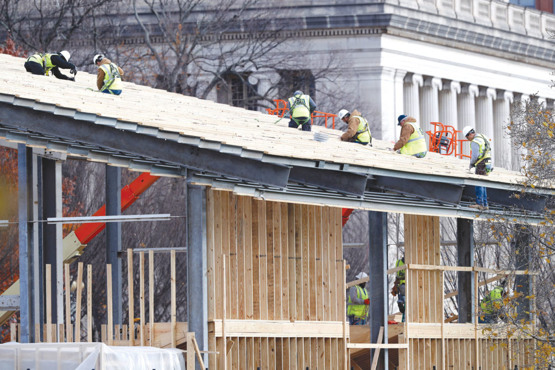 Construction continues on the presidential reviewing stand on Pennsylvania Avenue in front of the White House in Washington, Saturday, Nov. 26, 2016. The reviewing stand is where then President Donald Trump will view the inaugural parade on Jan. 20, 2017. (AP Photo/Alex Brandon)