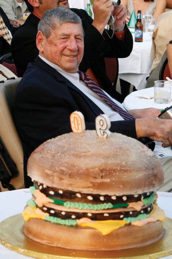 "In this Aug. 21, 2008, file photo, Big Mac creator Michael ""Jim"" Delligatti sits behind a Big Mac birthday cake at his 90th birthday party in Canonsburg, Pa. (AP Photo/Gene J. Puskar, File)"