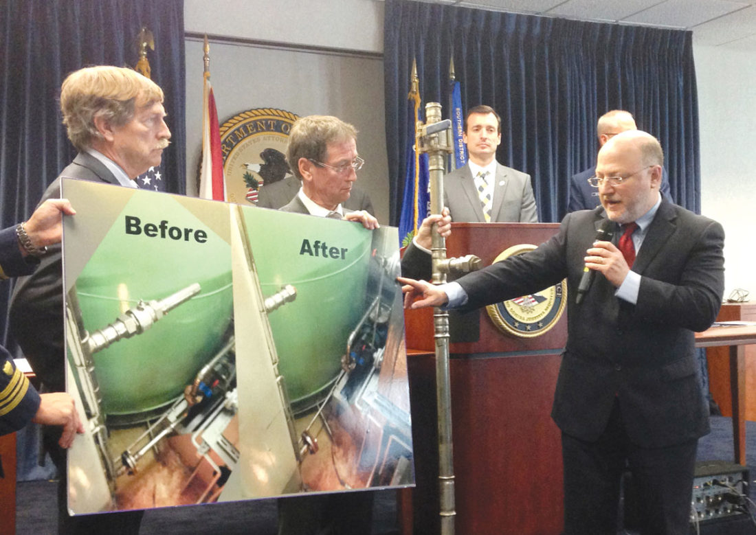 "Prosecutor Richard Udell, left, points to a photo showing the ""magic pipe"" before and after it was altered, during a news conference in Miami, Thursday, Dec. 1, 2016. (AP Photo/Curt Anderson)"