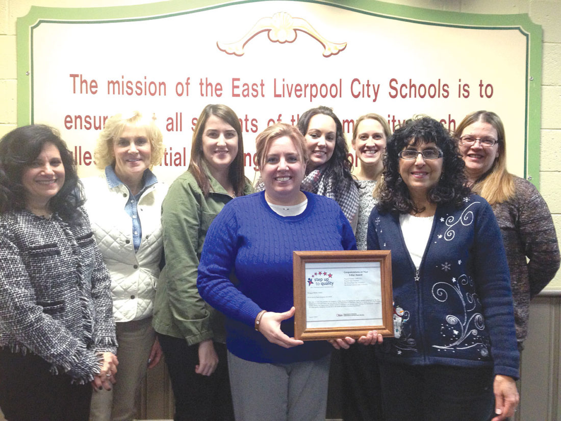 Teachers in the East Liverpool City School District preschool program were honored at Monday's school board meeting for achieving a coveted 5-Star rating, with (far left) Sheila Palumbo of the county ESC offering a presentation. Shown with Palumbo are teachers (front, from left): Sara Green and Mary Handley; (rear, from left): Kim White, Angela Altenhof, Sherry Blackburn, Megan Frederick and Billie Conrad. (Photo by Jo Ann Bobby-Gilbert)