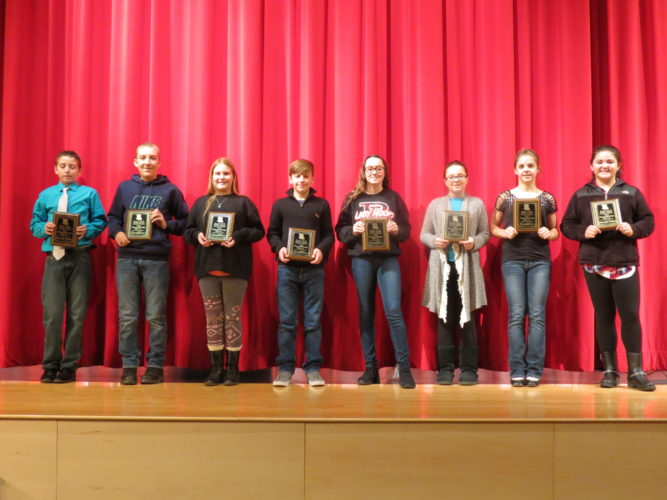 The top eight spellers from the Beaver Local Middle School Spelling Bee, which took place Wednesday at the Beaver Local Auditorium., include (from left) eighth-place Brady Smith, fourth-place Wyatt Crabtree, third-place Halen Warrick, champion Zach Smith, runner-up Olivia Keller, fifth-place Maggie Sell, sixth-place Jordan Palmer and seventh-place Shaylon Mackall. The top six advance to the Columbiana County Spelling Bee on March 5 in Lisbon. Brady Smith and Mackall will serve as alternates in the event any of the top six will be unable to compete. (Photo by Steve Rappach)