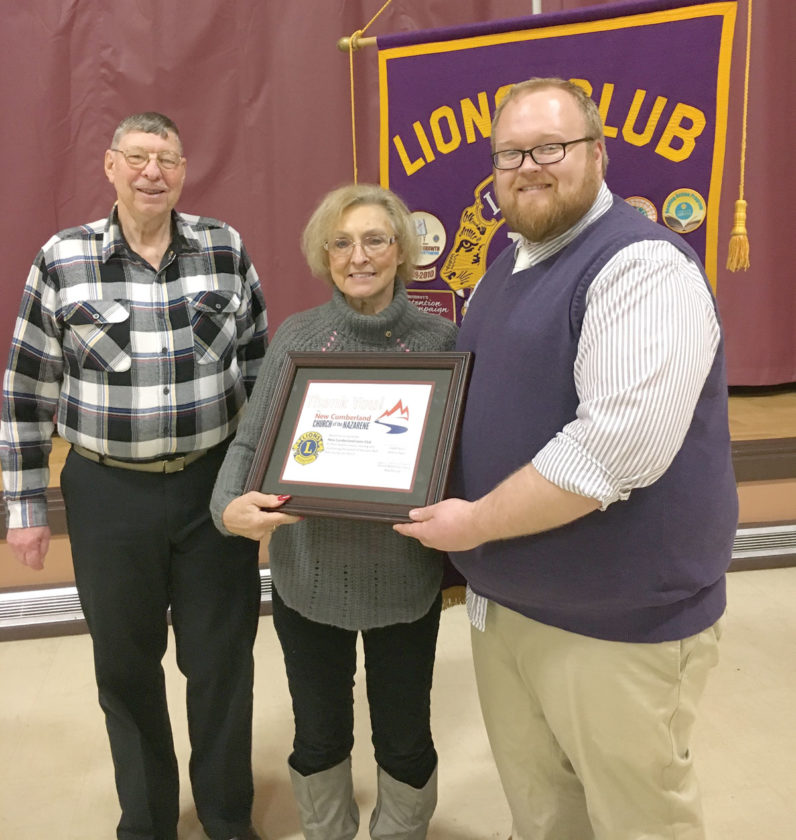 Pastor Jeremy Alger (right) presenting a certificate to President Barb Blackwell (center) with Lion Tom Stiles (left), chairman of the Adopt-A-Highway Project. (Submitted photo)