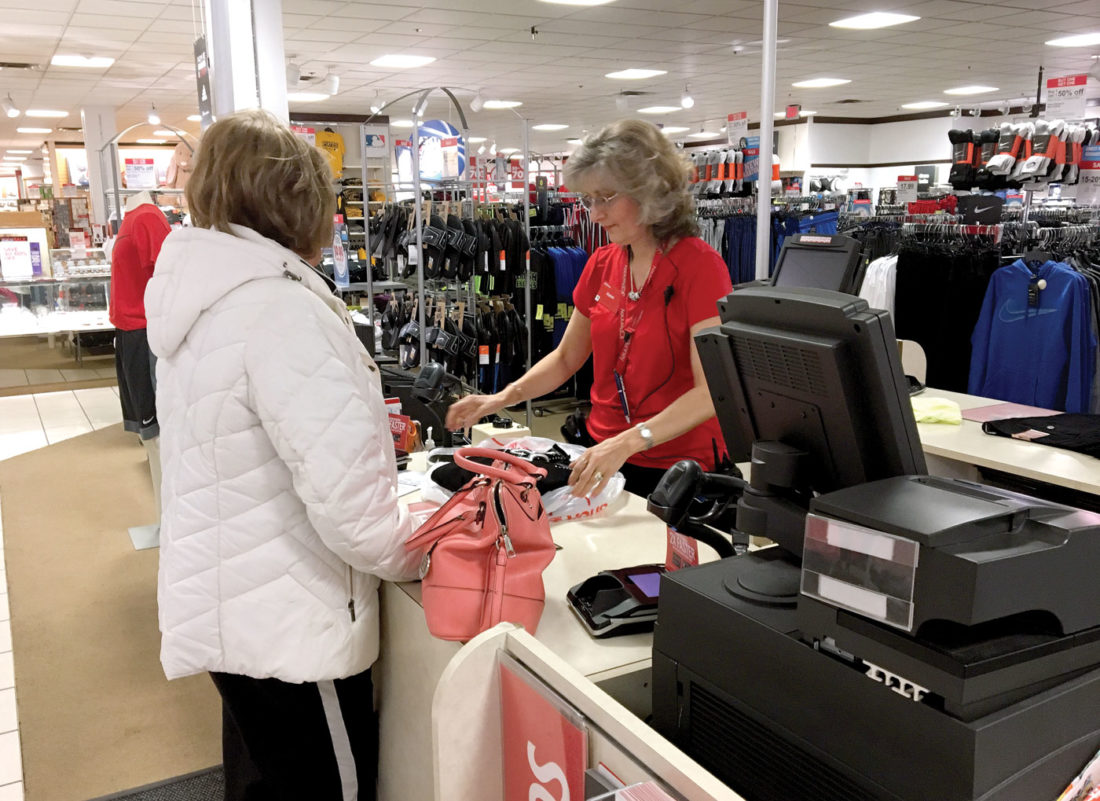 karen doyle a sales associate with jc penney assists a customer at the summit square store in calcutta which is not among the 138 stores nationwide