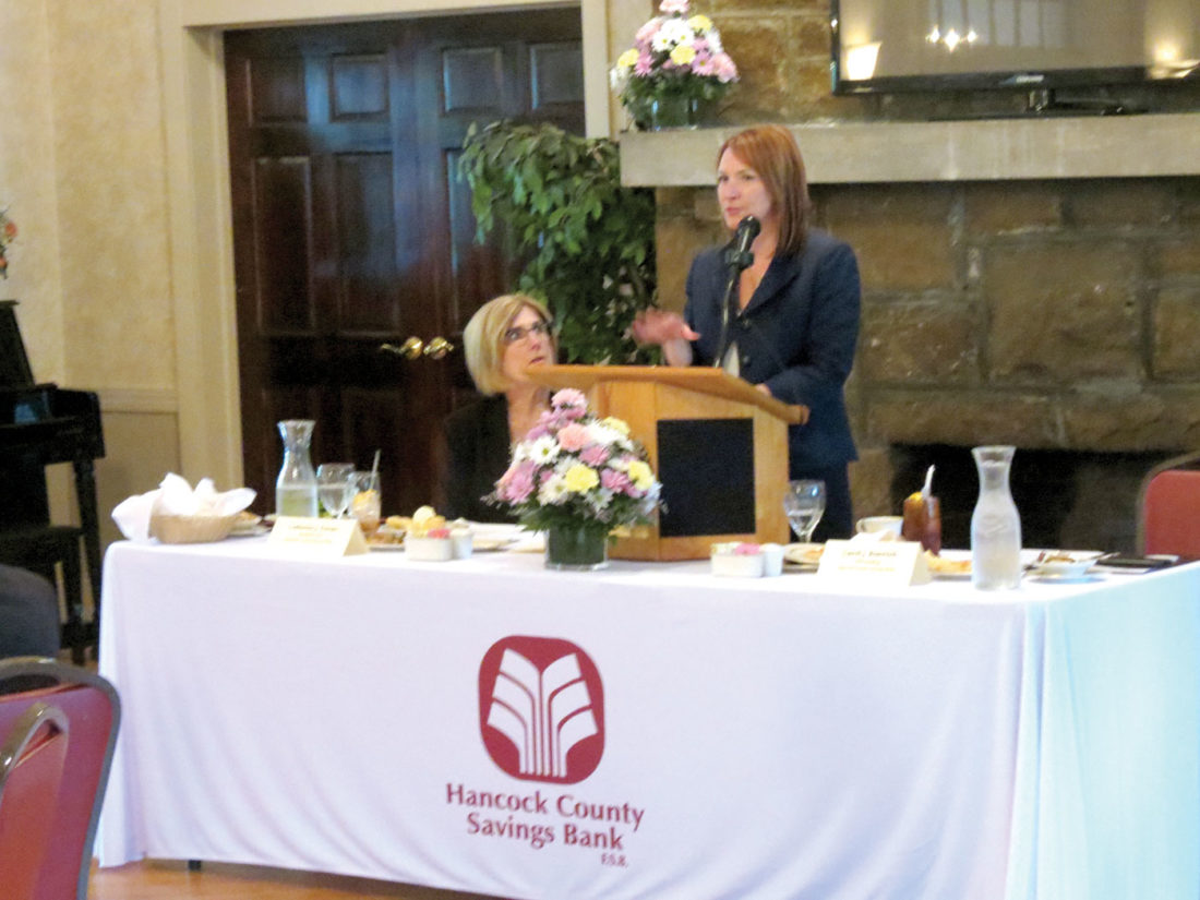 Caroll Rosenlieb, senior vice president of lending for Hancock County Savings Bank FSB, spoke about the bank's 80/20 Loan Program during a luncheon Wednesday at the East Liverpool Country Club. Seated near the dais is Catherine Ferrari, president and CEO of HCSB, who also spoke on the Hancock County Savings Bank Charitable Foundation. (Photo by Steve Rappach)