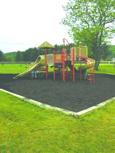 With the help of the Wellsville First Christian Church volunteers and a grant from Heritage Imaging, mulch was added to the playground area at Wellsville's Hammond Park. (Submitted photo)