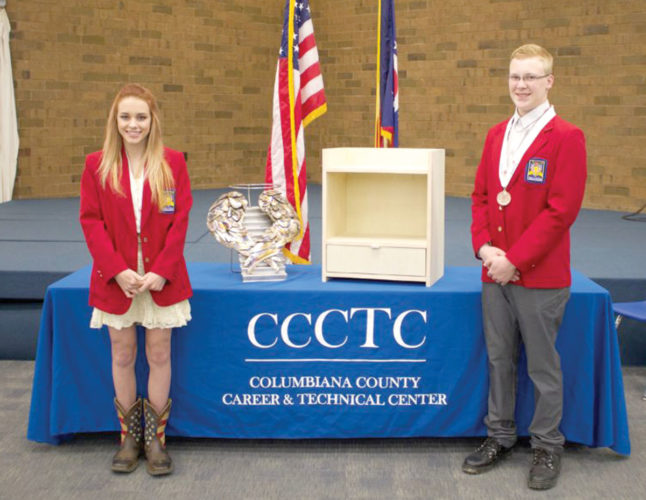Haley Peterson and Lucas Johnston displaying items they created to earn state honors (Submitted photo)