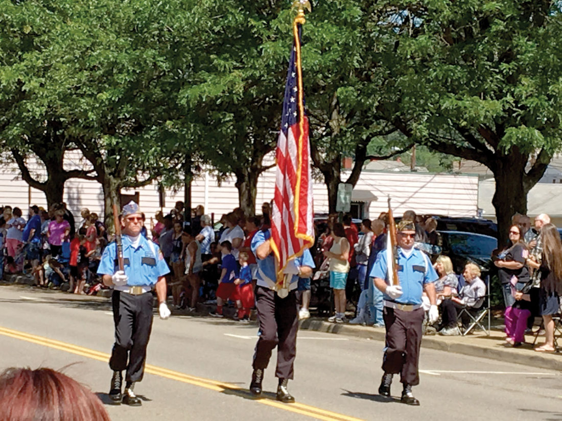 The Tri-State Veterans Color Guard process down West Sixth Street past East Liverpool City Hall during their city's Memorial Day parade, coinciding with the city's Memorial Day program Monday. Additional photos 8A. (Photo by Steve Rappach)
