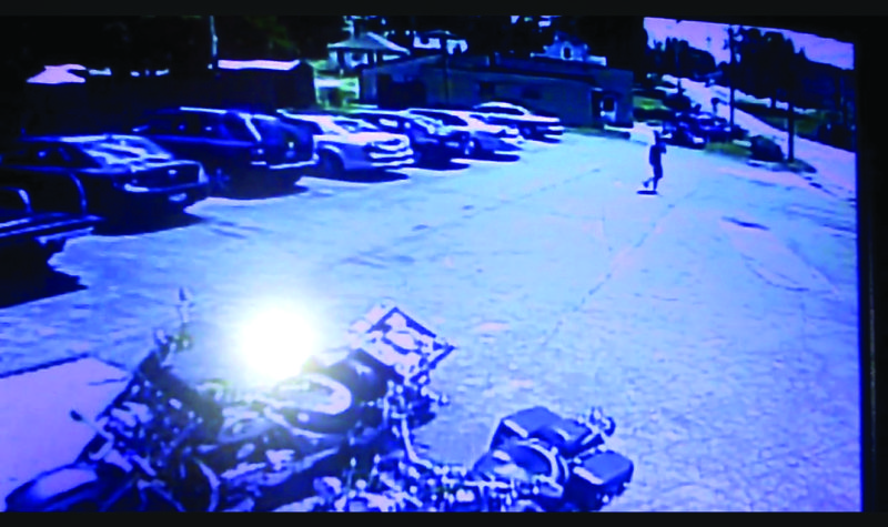 A video from security cameras at Dave 'N Deb's on Lisbon Street shows a man walking across the parking lot from a vehicle where a man was found dead early Sunday morning. The owner is offering a reward to try and find his identity. (Submitted photo)