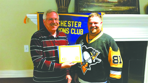 The Chester Lions Club recently welcomed new member Joey Davis, one of the owners of Davis Brothers Pharmacy in Chester and New Cumberland. He was sponsored by his father, Jeff Davis. Pictured is President Bob Milner (left) presenting Joey Davis with his Lions pin and certificate. For more information on the Chester Lions Club, visit its website at http://www.e-clubhouse.org/sites/chesterwv/index.php, or follow the Club on Facebook. (Submitted photo)