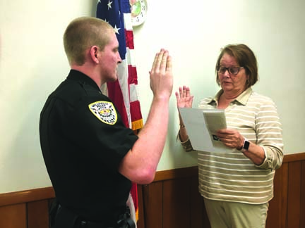 Wellsville Mayor Nancy Murray (right) swore in Chase Askounes as the village police department's newest part-time officer at the conclusion of Tuesday's Village Council meeting. Council approved Askounes' hiring with a 5-0 vote. (Photo by Steve Rappach)
