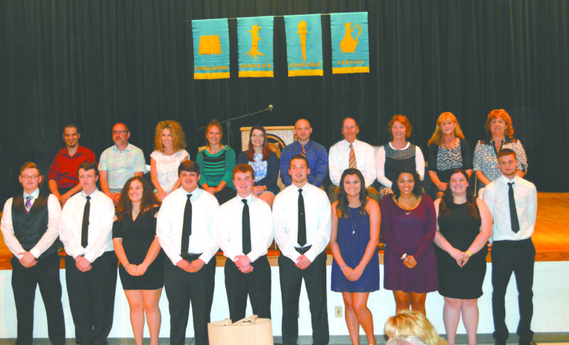 Each year, Wellsville Top 10 are given the honor of selecting a teacher/staff who has impacted their education (K-12) and inspired them to excel.  This year's Top 10 and their mentors include (front, from left) seniors Kenneth Durbin, Preston Sosack, Sara Dalrymple, Hunter Ulbright, Jacob Stewart, Payton Munoz, Kira Roe, Alexis Daniels, Jacob Green; and (back) mentors Charlie Kish, Bill Ricciardulli, Anne Cartwright, Ashley Kirkbride, Valentina Gheorghe, Jonathan Kinkead, Dan McKinstry, Marilyn Carr, Cindy Earich, and Robin Weeda. (Submitted photo)
