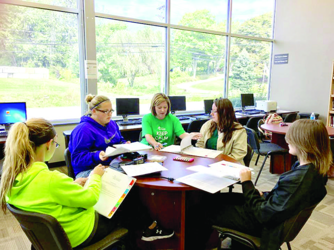 Dental Assisting Program director Jamie Stine, CDA, EFDA, works with students in the OVCT Media Center. (Submitted photo)