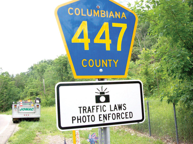 A traffic camera warning sign is affixed to the county's sign for county Road 447, Dresden Avenue, in Liverpool Township. (Photo courtesy of Columbiana County Engineer's Office)