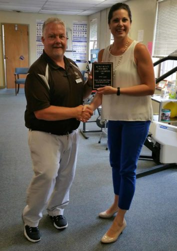 Lance Peterson (left), manager and physical therapist at Novacare Rehab in East Palestine, receives the Kent-EL Clinical Instructor of the Year award from Kathryn Sutton, clinical coordinator and academic advisor for the physical therapist assistant program at Kent-East Liverpool. (Submitted photo)