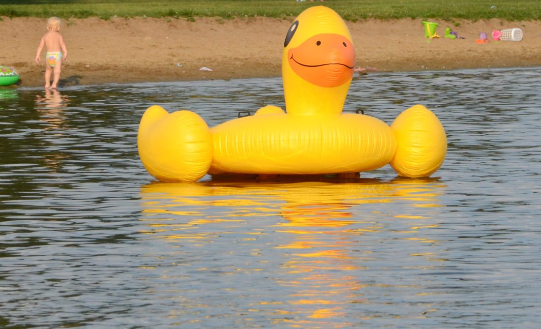 Perhaps unsuspecting as times, 14-year-old Michael Mosti of Highlandtown and 15-year-old Cody Little of Salineville cruised the waters of Guilford Lake under their giant duck float earlier this week, while temperatures were a bit warmer. Real ducks may have taken a liking to Friday's weather as it rained most of the day. The weekend forecast is calling for periods of rain with the chance of thunderstorms. (Photo by Patti Schaeffer)
